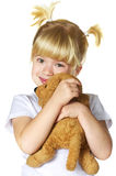 Little girl with her puppy toy Stock Photo