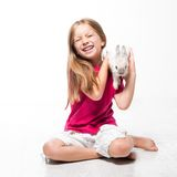Little girl with her rabbit Stock Photography