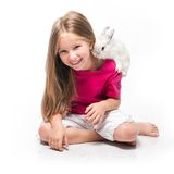 Little girl with her rabbit Royalty Free Stock Photo