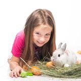 Little girl with her rabbit Stock Photos
