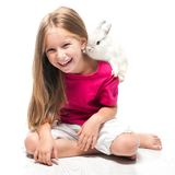 Little girl with her rabbit Stock Photo
