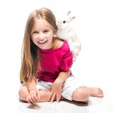 Little girl with her rabbit Royalty Free Stock Images