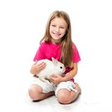 Little girl with her rabbit Royalty Free Stock Photography