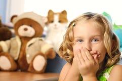 Little girl in her room. Stock Photos
