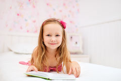 Little girl in her room Stock Photos