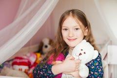 Little girl in her room Stock Photos