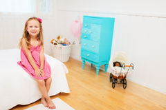 Little girl in her room Stock Images