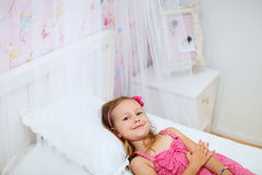 Little girl in her room Stock Photography