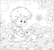 Little girl and her small rabbit. Smiling child playing with a bunny among flowers on a lawn on a summer day, black and white vector illustration in a cartoon vector illustration