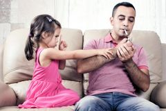 Little Girl And Her Smoker Father Stock Photography
