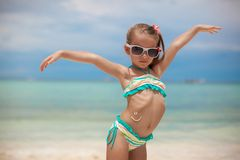Little girl on her stomach painted a smile by sun Stock Photography