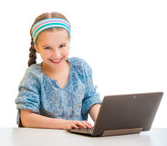 Little girl and her  tablet Royalty Free Stock Image