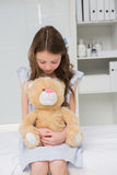 Little girl with her teddy bear in her harms Royalty Free Stock Photo