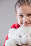 Little girl with her teddy bear Stock Images