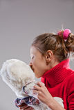Little girl with her teddy bear Stock Photography