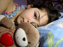 Little girl with her teddy bear. Little girl sleeping with her teddy bear royalty free stock photos