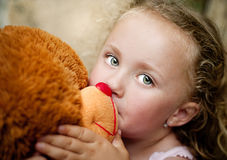 Girl with her teddy Royalty Free Stock Photography