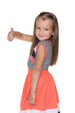 Little girl with her thumb up looks back Stock Image