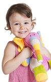 Little girl with her toy elephant. Three years little girl with her toy colorful elephant Royalty Free Stock Images
