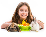 Little girl with her  two rabbits Stock Images
