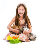 Little girl with her  two rabbits Royalty Free Stock Images