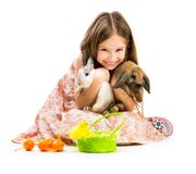 Little girl with her  two rabbits Stock Image