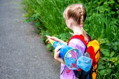 Little girl on her way to her first day of school.  stock photo