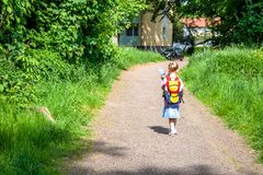 Little girl on her way to her first day of school.  stock images