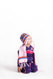 Little girl in her winter clothes Royalty Free Stock Photography