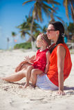 Little girl with her young mom relaxing on Stock Image