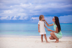 Little girl and her young mother relax at the Stock Images