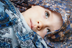 Little girl hidden in the scarf Royalty Free Stock Images
