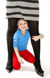 Little girl hide under mother legs Royalty Free Stock Photography