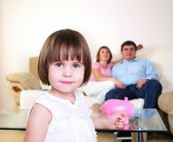 Little girl hides her money Royalty Free Stock Images