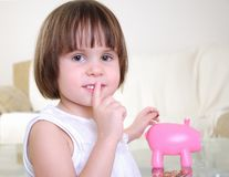 Little girl hides her money Royalty Free Stock Photography