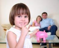 Little girl hides her money Stock Images