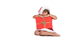 Little girl hiding behind Christmas gift Stock Photography