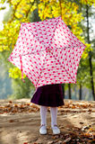 Little girl hiding behind umbrella Royalty Free Stock Image