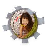 Little girl hiding inside the basket Stock Photos