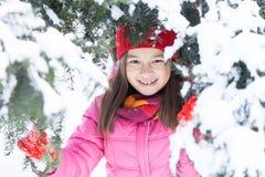 Little girl hiding in pine tree. Stock Images