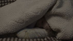 Little girl hiding under a blanket stock video footage