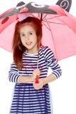 Little girl hiding under an umbrella. Stock Photography