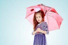 Little girl hiding under an umbrella. Royalty Free Stock Photo