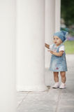 Little girl hiding in columns Royalty Free Stock Image