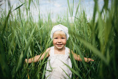 Little girl in high grass Royalty Free Stock Photos