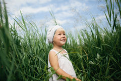 Little girl in high grass Royalty Free Stock Images
