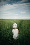Little girl in high grass Stock Photo