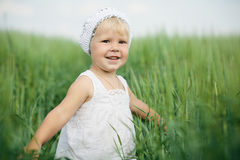 Little girl in high grass Royalty Free Stock Photo