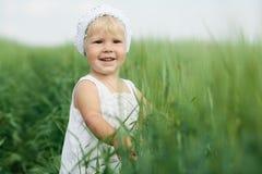 Little girl in high grass Stock Photos