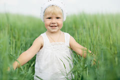Little girl in high grass Stock Images